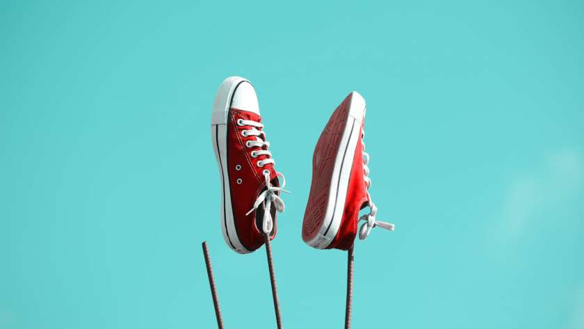 pair of red and white low top sneakers